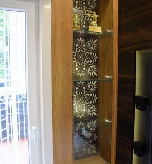 mdf jaali background with glass shelf storage