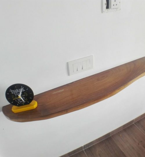 wooden ledge shelf on the wall